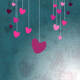 Hanging hearts on grunge Stock Images