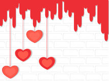Hanging hearts on the wall. . Stock Images