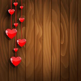 Hanging hearts on wooden background Royalty Free Stock Photography