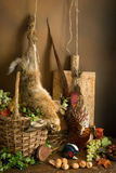 Hanging hunting game. Autumn still life with hunting products, pheasant and hare Stock Photography
