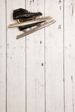 Hanging ice skates on wooden wall Royalty Free Stock Photos