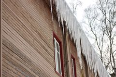 Hanging icicles pose a great danger to passersby royalty free stock image