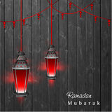Hanging illuminated Arabic lamps on wooden background Royalty Free Stock Image