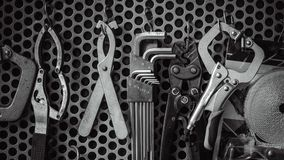 Hanging Industrial Tools Set On Wall stock photo