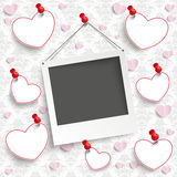 Hanging Instant Photo Hearts Ornaments Wallpaper. Batched instant photos with banner on the wallpaper with ornaments Stock Images