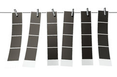 Hanging Instant Photograph Gallery. A 3D render of a gallery of six strips of blank photos from an instant photo booth pegged onto a steel cable on an isolated Stock Photo