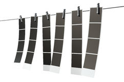 Hanging Instant Photograph Gallery. A 3D render of a gallery of six strips of blank photos from an instant photo booth pegged onto a steel cable on an isolated Royalty Free Stock Photography
