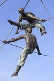 Hanging iron  figures balancing on ropes on footbridge Bernatka,Krakow, Poland Stock Photography