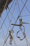 Hanging iron  figures balancing on ropes on footbridge Bernatka,Krakow, Poland Stock Photo