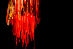Hanging jellyfish lantern with long ribbons in red and orange is Royalty Free Stock Photo