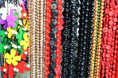 Hanging jewelry and beads stock photos