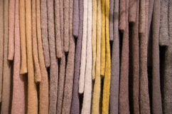 Hanging knit mohair sweater samples. Mohair knit sweater swatches hanging in assorted colors Royalty Free Stock Photos