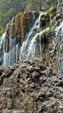 Hanging lake. Up and close to the water fall stock photo