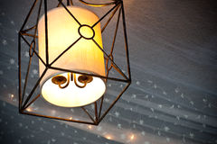 Hanging lamp glowing with tooling  and mini lights Stock Images