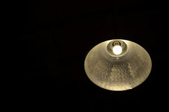 Hanging lamp and light bulb. On black background Royalty Free Stock Photos