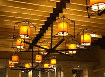 Ceiling lamp and light bulb. Hanging lamp and light bulb in hotel or restaurant Royalty Free Stock Photos