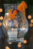 Hanging Lantern. Hanging lit candle sets mood at an outdoor party Stock Photos