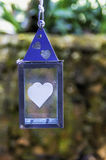 Hanging lantern with heart motifs Stock Photos