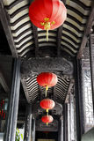 Hanging lanterns corridor. Red ball, yellow ribbon, black and white spacing of the roof Royalty Free Stock Photography