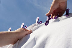 Hanging the laundry. Hanging out the washing on a line on a summer day Royalty Free Stock Photos