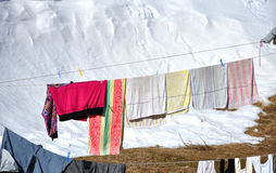 Hanging laundry drying on a clothesline Stock Photography
