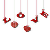 Hanging letters red love and hearts on a white background. Stock Photography