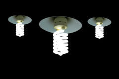 Hanging Light Bulb in the empty black background Royalty Free Stock Images