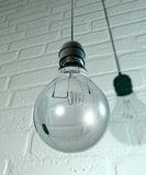Hanging Light Bulb And Fitting On A Wall Stock Photography