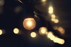 Hanging light bulb indoor. Decorate royalty free stock photos