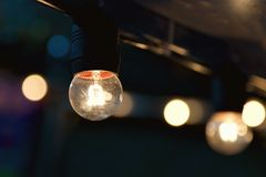 Hanging light bulb indoor. Decorate royalty free stock image