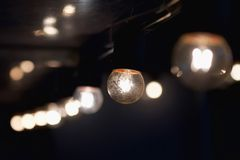Hanging light bulb indoor. Decorate royalty free stock photography
