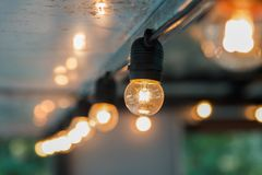 Hanging light bulb indoor. Decorate stock photography