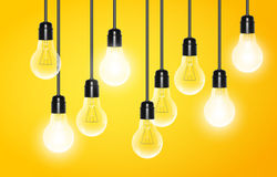 Hanging light bulbs with a few glowing on yellow background. Vector illustration for your design. Royalty Free Stock Photo