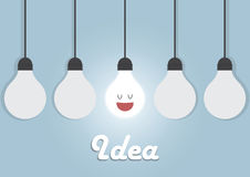 Hanging light bulbs with glowing one Royalty Free Stock Photo