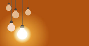 Hanging light bulbs one of them glow,  illustration. On yellow background with copy space Royalty Free Stock Photo
