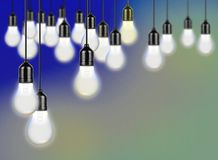Hanging Light bulbs. Over Blue Background Royalty Free Stock Photo
