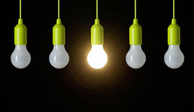 Hanging light bulbs in a row Stock Photography