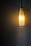 Hanging light whit wall Royalty Free Stock Images