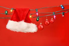 Hanging lights with santa hat Stock Photo