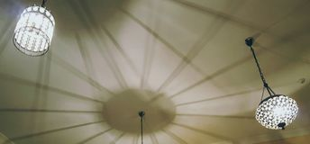 Hanging lights. Shadows cast on ceiling from crystal hanging lights Stock Photography