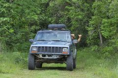 Hanging loose while driving off road in jungle royalty free stock image