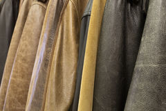 Hanging a lot of leather jackets Stock Photos