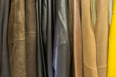 Hanging a lot of leather jackets Stock Photo