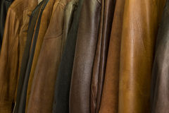 Hanging a lot of leather jackets Royalty Free Stock Photos