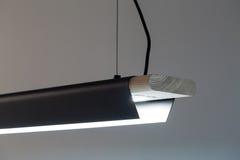 Hanging luminous wooden-metallic lamp Royalty Free Stock Photos
