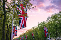 Hanging Mall flags. Lines of union jack flags hanging along the Mall, London Royalty Free Stock Photography