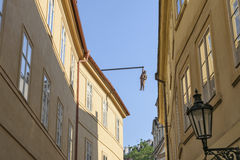 Hanging man, Sigmund Freud hanging intellectual. Street Husova in Prague Royalty Free Stock Photo