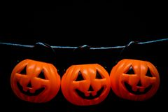 Hanging many horror or scary pumpkin for Halloween Day concept. Royalty Free Stock Photos