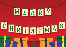 Hanging Merry Christmas Sign with Presents Underneath Stock Image