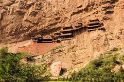 Hanging monastery temple near Datong, China. Hanging monastery temple suspended on long wooden poles near Datong, China, touristic spot in Shanxi Province Stock Photos